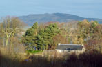 Bishops Hill and the gate house at the source of the River Leven
